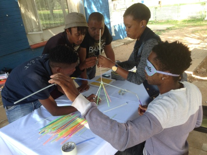 "Parys team doing the activity ""Tallest structure"""