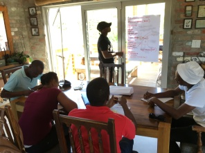 Sizwe facilitating music and health for the team in Stellenbosch